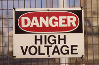 Photo shows a high voltage warning sign