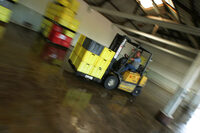 photo shows a forklift truck in a warehouse