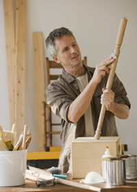 image of a man working with wood