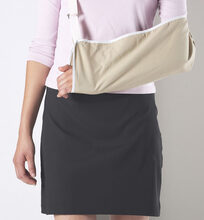 Photo shows a woman with one arm in a sling
