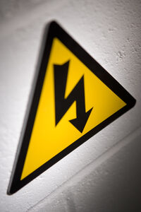 Photo shows a high voltage electricity warning sign
