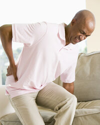 Photo shows a man with back pain