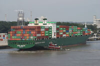 Photo shows a cargo ship transporting goods