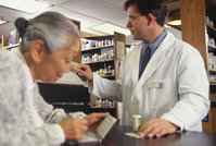 Photo shows a pharmacist at work