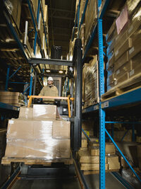 Photo shows a reach truck in a warehouse