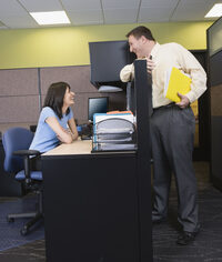 Photo shows happy people talking in an office
