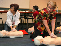 Photo shows a first aid training session
