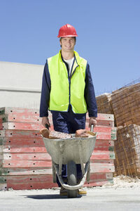 Photo shows a worker on a construction site