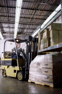 Photo shows a forklift being used in a warehouse
